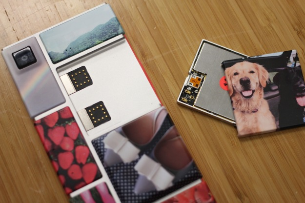 Project Ara Phone prototype showing one removed module with an image of two dogs on the back. Each module is printed with a different picture to highlight its customizability.