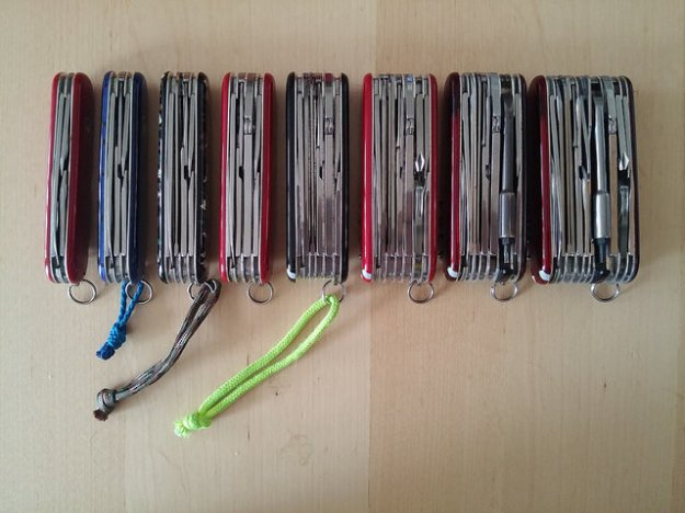 Image shows 8 Swiss Army knives from left to right with an increasinly large number of functions.