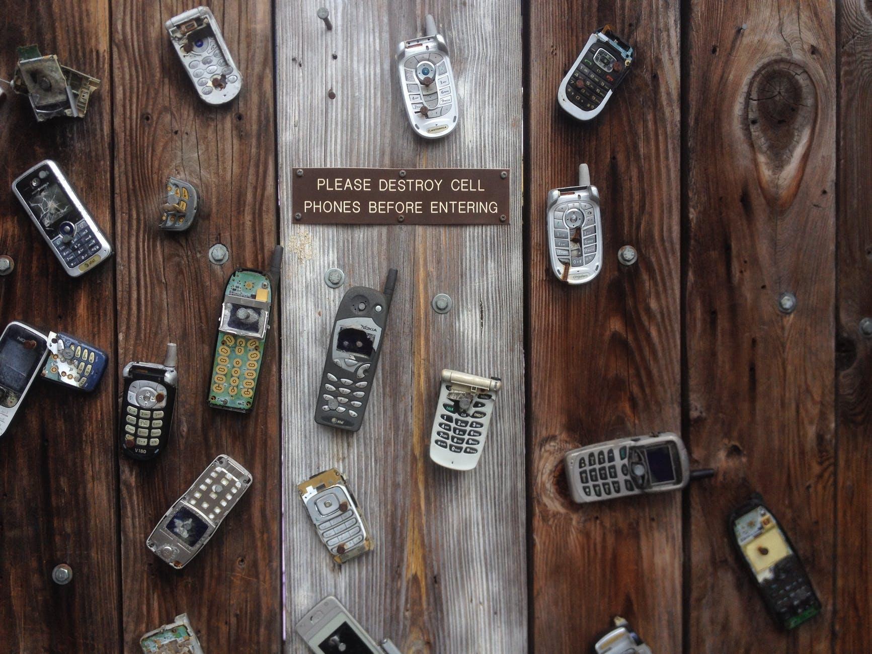 antique broken cell phone communication