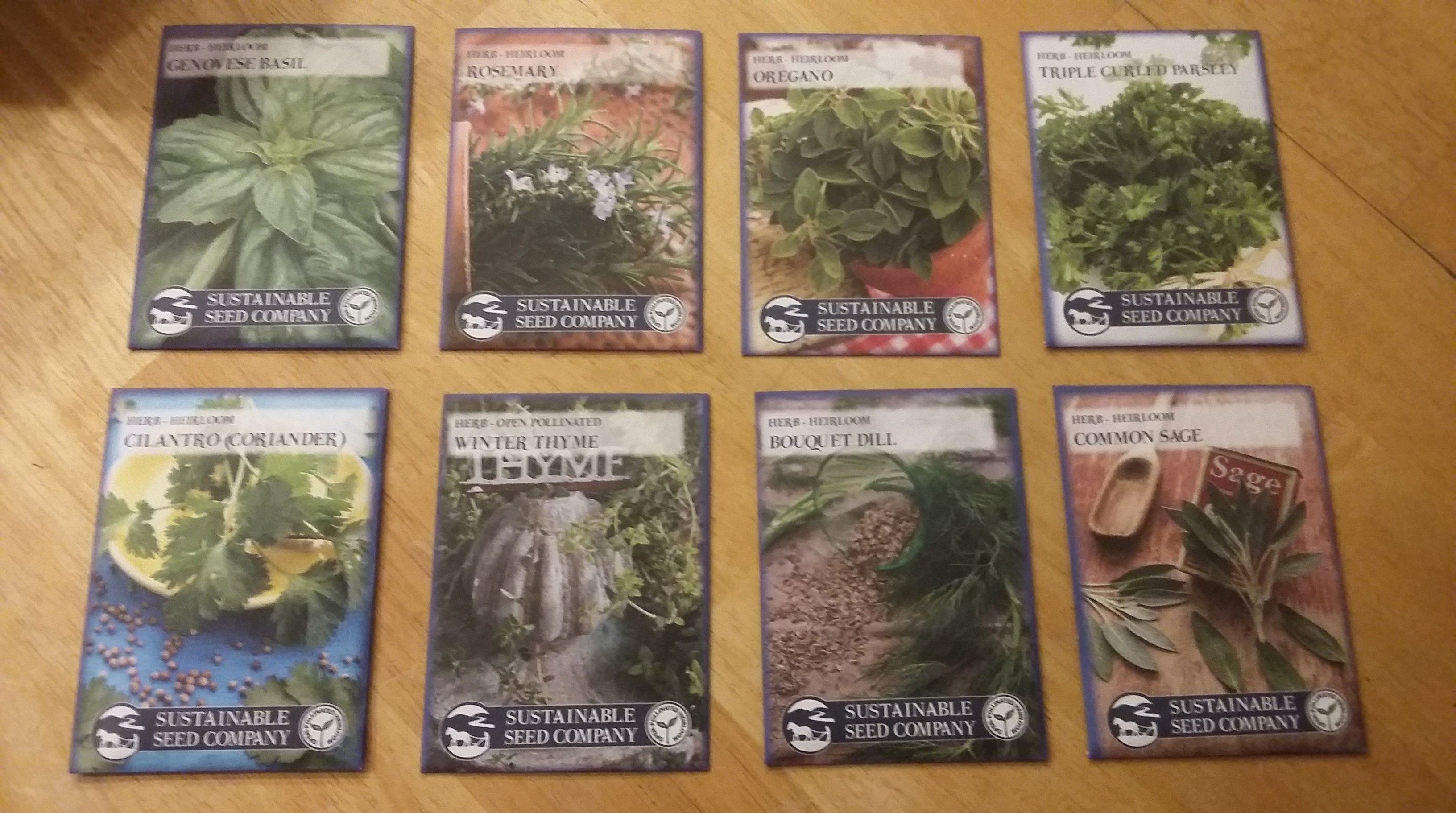 8 herb packets arranged in two rows and four columns. The herbs include basil, rosemary, oregano, parsley, cilantro, thyme, dill, and sage.