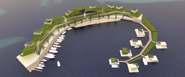 An artificial island in a rough c-shape. It is covered in grass and has several berths for boats.